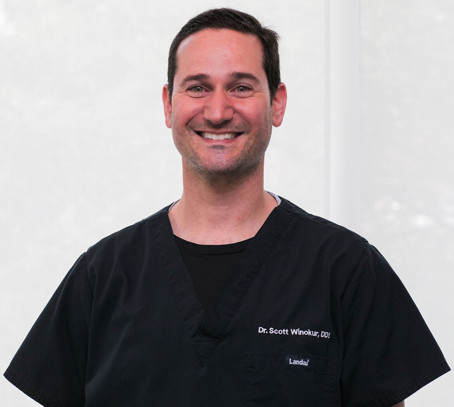dr winokur headshot in black scrubs